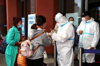 الصين : 13 إصابة جديدة بكوفيد19
