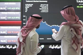 سوق الأسهم يغلق مرتفعا ويتجاوز الـ 11.900 نقطة